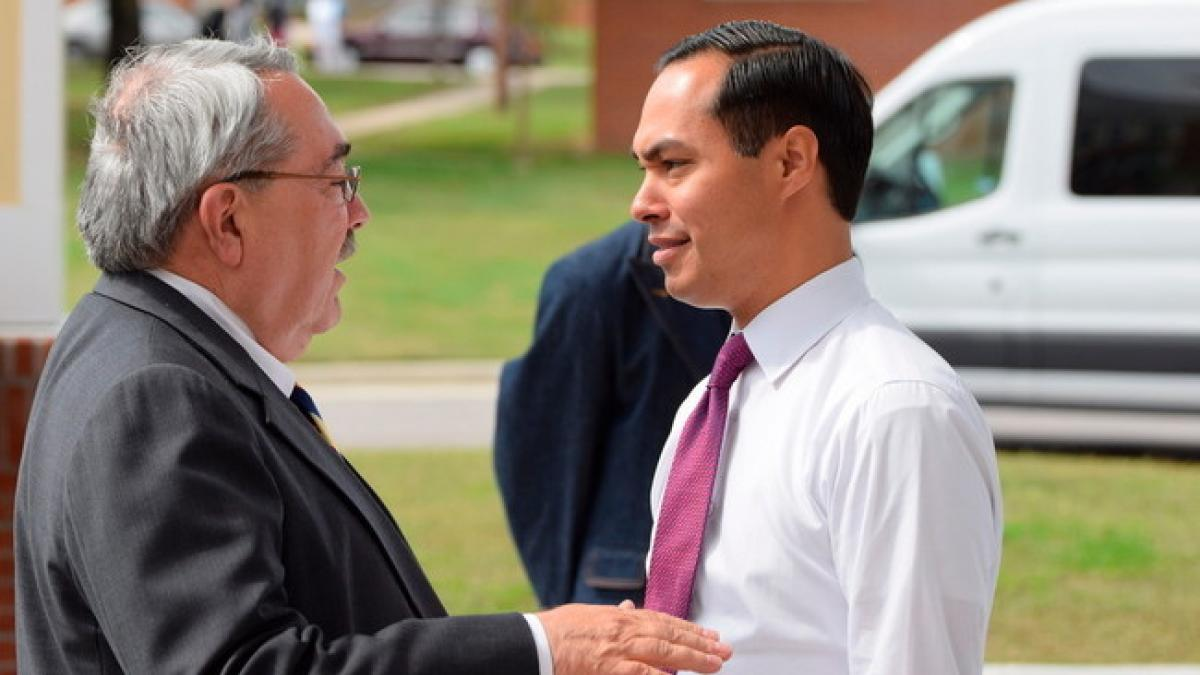 Rep. G.K. Butterfield, a Wilson Democrat representing North Carolina's 1st Congressional District, speaks with HUD Secretary Julian Castro on Tuesday. Bill Howard   Special to the Times