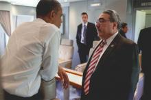 Congressman Butterfield speaking with President Obama aboard Air Force One