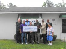 Congressman Butterfield presenting a check to the town of Cofield, North Carolina