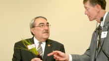 Congressman Butterfield speaking to a representative of the agricultural industry