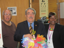 Congressman Butterfield with artwork from a student