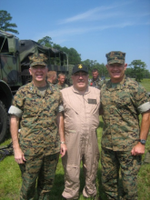 Congressman Butterfield taking a photo with soldiers